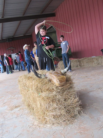 Staff photo by Cathy Spaulding<br /> Oklahoma School for the Blind seventh-grader Rayce Phillips swings a lasso toward a dummy calf during OSB's Western Heritage Days at  Silver Spur Western Lodge.