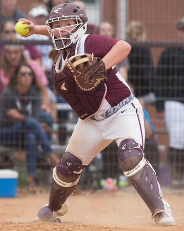 Phoenix special photo by Von Castor<br /> Sequoyah's Ryleigh Clinton throws to first after fielding the bunt of a Beggs hitter in the Class 3A fastpitch regional Wednesday at Sequoyah High School.