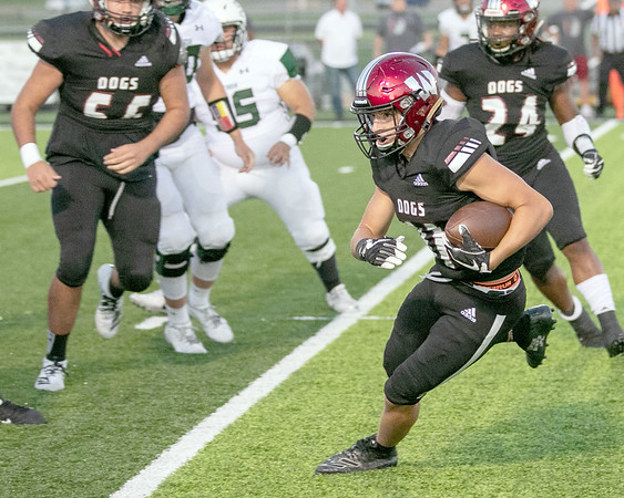 SHANE KEETER/Special to the Phoenix<br /> Wagoner's Kaden Charboneau returns an interception against Catoosa on Friday, setting up a Bulldogs' touchdown in the first quarter. Wagoner beat Catoosa 56-7.