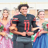 CATHY SPAULDING/Muskogee Phoenix<br /> T.J. Maxwell stands between Cara York, left, and Isa Morrow, after the coronation of Hilldale All-School Homecoming King and Queens. Two queens were crowned Friday.