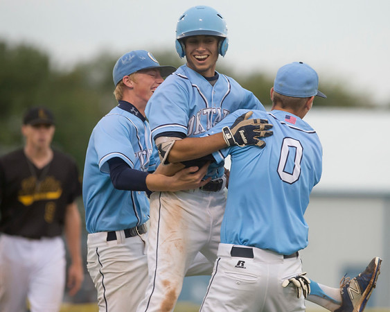 Phoenix special photo by Von Castor<br /> Oktaha's Ty Meaders, middle, celebrates with teammates after his walkoff single to beat Latta 4-3 and advance to the Class A fall state baseball tourney.