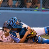 Phoenix special photo by Von Castor<br /> Oktaha catcher Karli Ashing hangs on to the ball after tagging out a Pocola baserunner at home plate Thursday night at Oktaha.