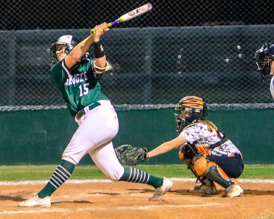Phoenix special photo by John Hasler<br /> Muskogee's Kayleigh Phillips uncorks on a three-run home run in the bottom of the first. Muskogee won the Senior Night and home finale, 7-6.