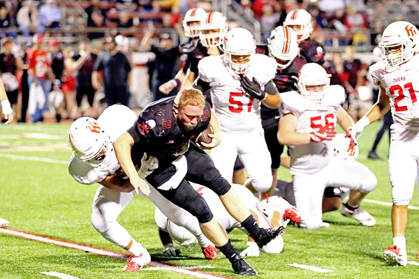Fort Gibson's Tegan Thornbrough brings down Poteau's Easton Francis in the backfield during Friday's game in Poteau.