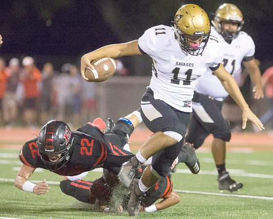VON CASTOR/Special to the Phoenix<br /> Hilldale's Bryce Barrett trips up Broken Bow's Brian Garrett in the backfield Friday night in the Hornets' 46-14 loss.