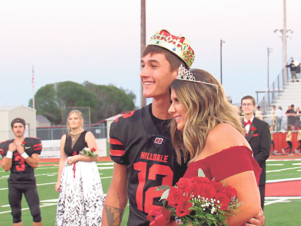 CATHY SPAULDING/Muskogee Phoenix<br /> Hilldale All-School King Kade Romine and All-School Queen Cara York smile at the crowd after their coronations Friday at the Hilldale Hornets football game.
