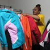 CATHY SPAULDING/Muskogee Phoenix<br /> Coats, including children's coats will soon be in high demand at church clothing closets. Kim Syrus sorts through clothes at All Nations Community Clothes Closet in Haskell.