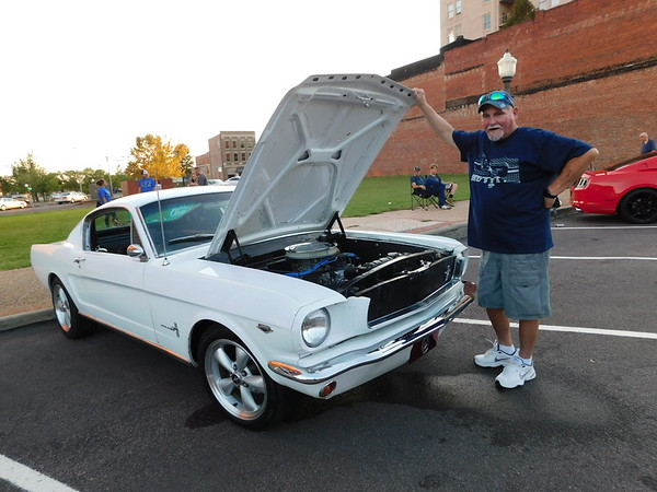 KENTON BROOKS/Muskogee Phoenix<br /> Mark Bush proudly stands by his 1965 Mustang after friends and<br /> members of the Muscle Mustangs of Oklahoma club teamed up to fix the car to get it running again. Bush has been diagnosed with severe chronic heart problems and has owned the car for 27 years. It has not run until Saturday when Bush drove up to the Cruisin Muskogee at Green Space between Third and Fourth Streets on Broadway in downtown Muskogee.