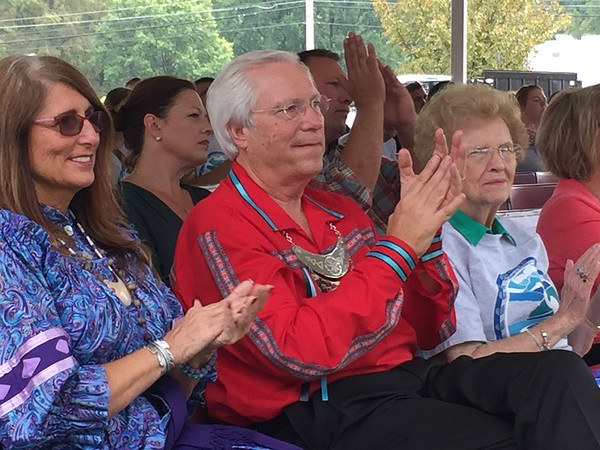 Staff photo by Mike Elswick<br /> Cherokee Nation Principal Chief Bill John Baker, center, applauds along with his wife, Sherry Baker, left, and his mother, Dr. Isabel Baker, during a presentation as part of the annual Cherokee State of the Nation speech Saturday in Tahlequah.