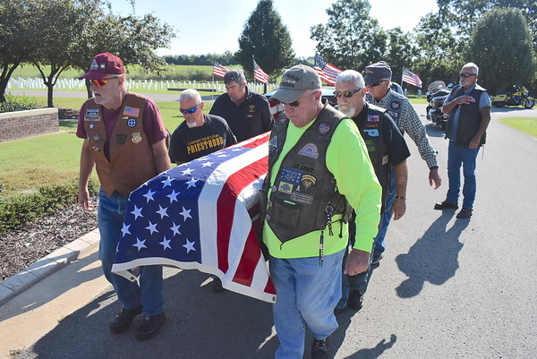 Staff photo by Mark Hughes<br /> The casket of Navy veteran Kenneth Kinser, 83, is carried by members of Patriot Guard Riders and The Priesthood Motorcycle Ministry  Tuesday at the Fort Gibson National Cemetery. Kinser died with no family members remaining.