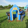 CATHY SPAULDING/Muskogee Phoenix<br /> Members of the Seventh Sin Motorcycle Club, Three Rivers Chapter, set a clubhouse into the Fort Gibson Head Start playground.