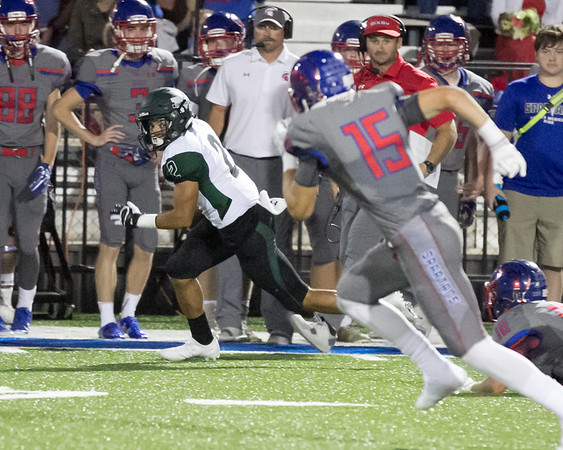 Phoenix special photo by Shane Keeter<br /> Muskogee's Diante Crutchfield breaks away for a touchdown on Friday at Bixby. The Roughers lost 38-23.
