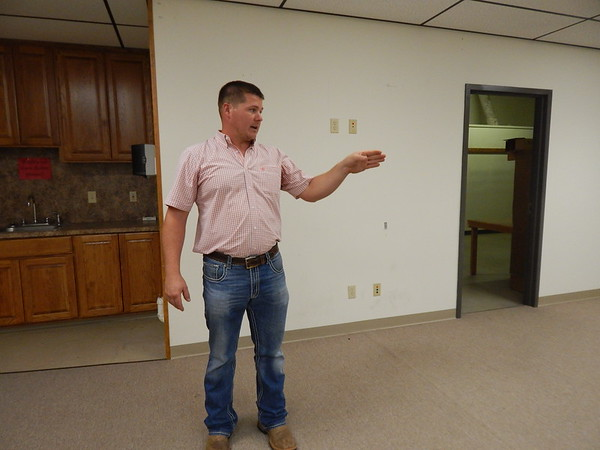 KENTON BROOKS/Muskogee Phoenix<br /> Checotah Mayor Daniel Tarkington discusses the plans for the new city hall that will be located in the old Sharpe's Department Store building at 200 N. Broadway. The city has used the building at 414 W. Gentry for 17 years and was formerly a doctor's office.