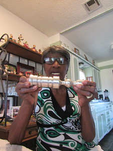CATHY SPAULDING/Muskogee Phoenix Mary Ankrom shows a metal candlestick she made while working in the machine shop at Coburn Optical. She worked at Coburn for 25 years.