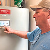 """CHESLEY OXENDINE/Muskogee Phoenix<br /> Rural Water District 7 manager Brad Clinkenbeard inspects a monitor at the new pump station in Fort Gibson. The station """"doubles"""" the district's pumping capacity, said Clinkenbeard."""