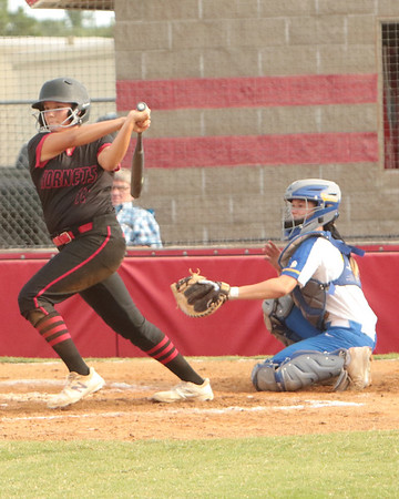 JOHN HASLER/Phoenix special photo<br /> Hilldale's Addy Wolfe drives in two runs batted in and a single in front of Berryhill catcher Megan Fortner on Tuesday.