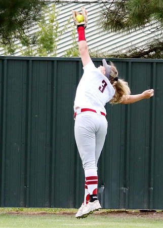 Phoenix special photo by John Hasler<br /> Abi Scott robs Sallisaw's Katie Scott of a hit with an over-the-shoulder catch near the wall in center field. Scott and Fort Gibson won 10-0 on Tuesday.