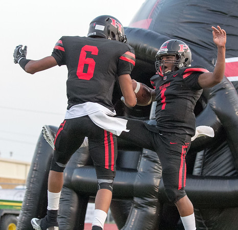 Phoenix special photo by Shane Keeter<br /> Mikey Winston, right, celebrates with Devin Hembry after scoring a touchdown in last week's 68-8 win over Miami.