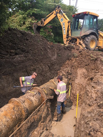 Staff photo by D.E. Smoot<br /> Maintenance II workers Connor Beauvais, left, and Seth Strader prepare a leaking 24-inch water main for repairs Tuesday on Court Street.