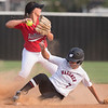 Phoenix special photo by Von Castor<br /> Hilldale's Taylor Sanchez tries to turn a double play as Wagoner's Macy Robertson slides into second base Tuesday afternoon at Wagoner.