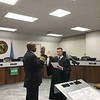 D.E. SMOOT/Muskogee Phoenix<br /> Municipal Judge John Tyler Hammons, right, administers the oath of office to Muskogee Fire Chief Derrell Jones, who was appointed in August to succeed Retired Chief Mike O'Dell. Jones hired on with the Muskogee Fire Department in April 1985, working his way through the ranks, from driver to captain and training officer before he became assistant fire marshal in 2012. He was appointed in 2017 as fire marshal before taking the helm as chief, a position that became effective Aug. 31.
