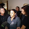 Staff photo by Wendy Burton<br /> Misty Martin-Sullins, center, talks with reporters after a judge signed a court minute releasing her ex-husband from serving any further weekends in jail. Martin-Sullins said Mark Ridley's sentencing was a miscarriage of justice and serving 10 weekends in jail is not enough.