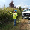 KENTON BROOKS/Muskogee Phoenix<br /> Jadon Vanderslice, of Bacco Tree Service of Claremore, sprays chemicals on vegetation under power lines on South Country Club Road on Thursday for East Central Electric Cooperative to prevent growth from reaching the wires. Vanderslice, who is from Okemah, said the work began at 6 a.m. and continued until 8 p.m. Similar work was also done in Haskell, Summit, Wainwright and other locations in the area, he said.