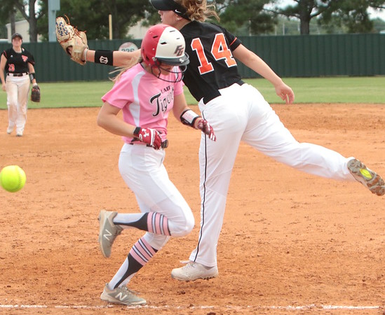 JOHN HASLER/Phoenix Special Photo<br /> Baleigh James gets to first on a wild throw to Tahlequah first baseman Hailey Sams in Thursday's game at Fort Gibson. The host team won 9-0.