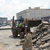 CATHY SPAULDING/Muskogee Phoenix<br /> Grace Episcopal Church member Henry Miller unloads dirt on a pile of broken concrete Thursday while helping prepare an area along Sixth Street for a memorial garden. The church plans to build the garden in the footprint of a former building south of the church. Margaret's Garden is to be a memorial for longtime church member Margaret Cain, who died last winter. The garden will feature a labyrinth, trees, picnic tables, benches and boulders where people may sit. There also will be a parking area. It is to be built in phases as a green space for the community.