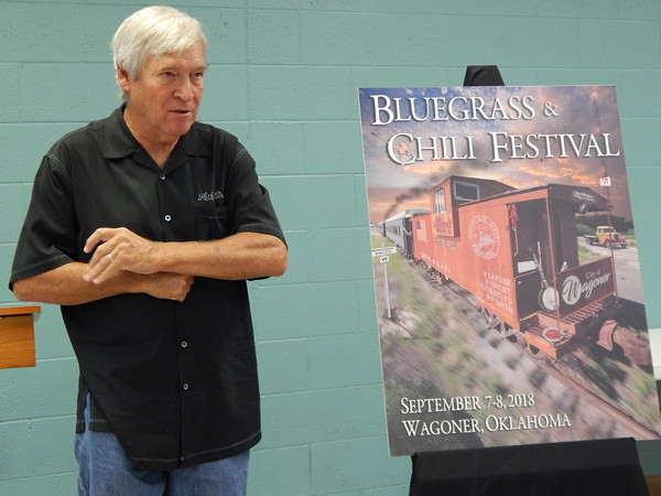 Douglas Henderson talks about the poster he designed for the Sept. 7-8 Bluegrass and Chili Festival. Henderson, an Oklahoma native, said it took him 10 hours to work on the poster from start to finish.