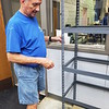 CHESLEY OXENDINE/Muskogee Phoenix<br /> Volunteer Larry Hoffman assembles a new shelf at the Muskogee Community Food Pantry during Friday's Lake Area United Way Day of Caring.