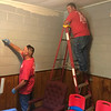 Oklahoma Natural Gas employees Dalton McCullar (left) and Trey Culp (right) paint a room in the Salvation Army building during the United Way Day of Caring.