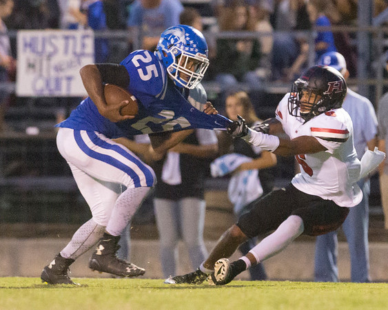 Phoenix special photo by Von Castor<br /> Hilldale's Devin Hembry takes down Checotah's Ronny Hall in the backfield<br /> Friday night at Checotah.