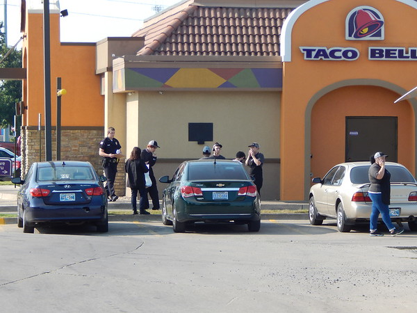 Staff photo by Wendy Burton<br /> Taco Bell employees wait outside as Muskogee police investigate an armed robbery that occurred there Friday morning.