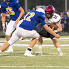Phoenix special photo by Shane Keeter<br /> Wagoner's Blake Dumond, right, tries to break through the tackle of Pryor's Will Considine during Friday's game at Pryor.