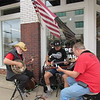 CATHY SPAULDING/Muskogee Phoenix<br /> The Mountain Grove Bluegrass Band picks in front of Hoopes Hardware during Saturday's Arts and Artisans on Main Fall Arts and Crafts Crawl.