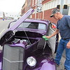 CATHY SPAULDING/Muskogee Phoenix<br /> John Frazier polishes his 1933 coupe, which he displayed Saturday at the Greased Lightning Meets Rolling Thunder. It was one of three activities drawing people downtown on Saturday.