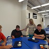 KENTON BROOKS/Muskogee Phoenix<br /> Checotah High School principal Jennifer Campbell talks with football players, from left, Todd Lackey, Tyler Whitlock, Dakota Dugger and Jeremy Dock, during the lunch hour in the cafeteria. Campbell, an assistant principal for three years, replaces Brian Terry after Terry left to become the superintendent of schools at Beggs.