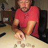 "CATHY SPAULDING/Muskogee Phoenix<br /> Aaron Dunlap shows a small sampling of ""relics"" he found while metal detecting. He likes researching the items to learn their stories."