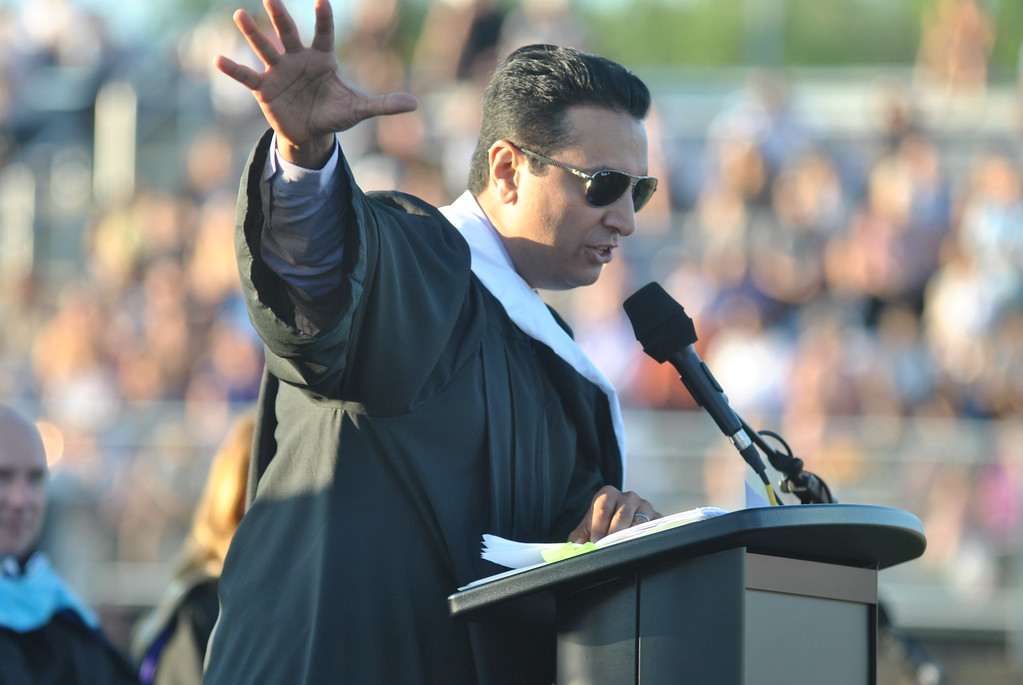 . Phoenixville �93 graduate and ESPN anchor Kevin Negandhi delivers the keynote address during the Phoenixville Area High School commencement ceremony at Washington Field June 9.  Barry Taglieber � For Digital First Media