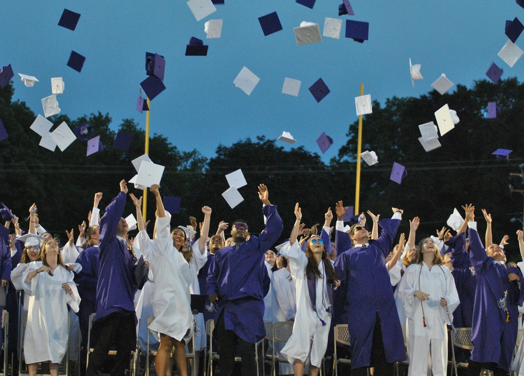 . Members of the Phoenixville Area High School Class of 2017 throw their caps in the air after graduating at the school�s commencement ceremony at Washington Field June 9.  Barry Taglieber � For Digital First Media