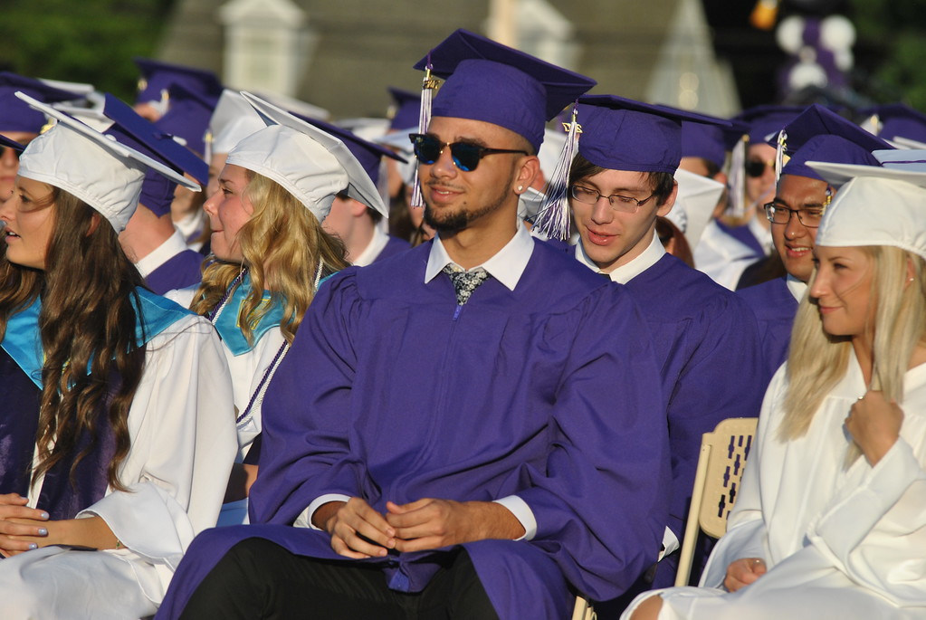 . Shyheim Mustafa Abernathy listens to speeches during the Phoenixville Area High School commencement ceremony at Washington Field June 9.  Barry Taglieber � For Digital First Media