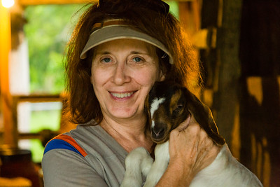 Kelly Kerr holds a baby goat in a barn in Loxahatchee Groves during a stormy afternoon on Thursday, June 15, 2017. (Joseph Forzano / Deep Creek Films & Photography)