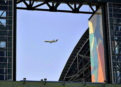 An airplane landing over Chase Field (Arizona Diamonbacks baseball field).