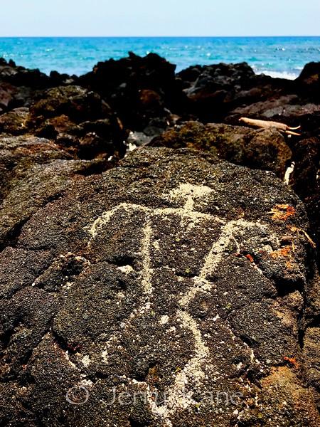 Ancient Hawaiian petroglyph at Puako Beach on the Big Island.