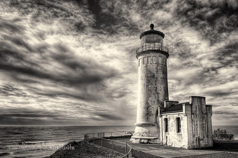 "North Head Lighthouse<br /> Cape Disappointment State Park, Ilwaco, Washington<br /> This is a slightly different  composition taken in camera than the last version.  The lighthouse in this is more on the third as well as the fence plays more of a role in the leading lines.  I also toned this differently in Silver Effex 2.  Here is the link to the other image.  <a href=""http://www.ilenesamowitz.com/PhotoADay/PAD-2012/PAD-2012/i-QBHwFrv/1/L/20120331-IS445212345HDRX2BW-2-L.jpg"">http://www.ilenesamowitz.com/PhotoADay/PAD-2012/PAD-2012/i-QBHwFrv/1/L/20120331-IS445212345HDRX2BW-2-L.jpg</a>"