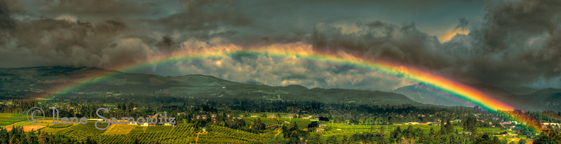 8-3 This is the entire rainbow that I captured that morning.  It is nine image panorama that was made from 5 exposures for each of the frames.  The files are very large since they come from my D800e so my computer had to chug away.  I did the HDR conversion before doing the stitching.  I then had to downsize the image to be able to upload it to Smugmug but this jpeg is still 60.8 MB.
