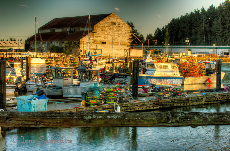 10-29-12 La Conner Waterfront.  I find this town on the Swinnomish Channel to be a vibrant and fun place to photograph.  This was taken across the channel from the town's main street.  This was processed in Photomatix Pro and Color Effex Pro.  <br /> <br /> Critiques welcome and appreciated.
