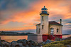 9-29-12 Coquille Lighthouse Sunset - This is a two exposure HDR made from long exposures using a 10 stop ND filter.  I processed this in photomatix and Color Effex pro 4.0.    Critiques Welcome.