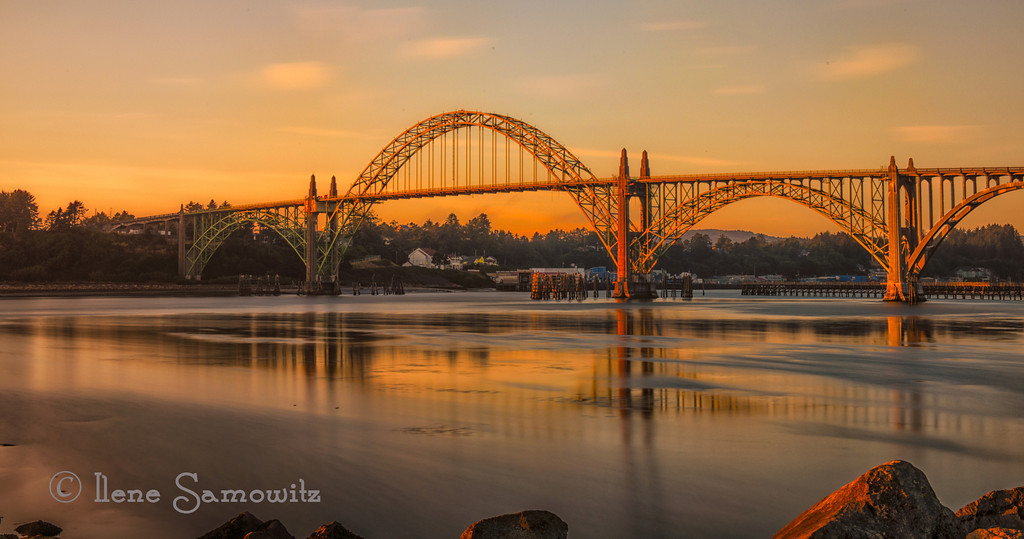 9-6-12 Yaquina Bay Bridge at Golden Hour - This single image was taken at f22 ISO 100 and a shutter speed of 143 seconds.   I used my ten stop ND filter on this and it resulted in extra warm light on the bridge, the sky, and the reflection.  <br /> <br /> Critiques welcome.